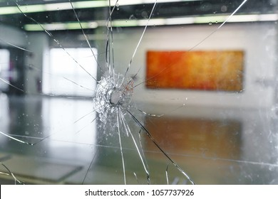 Broken window glass as robbery and crime concept