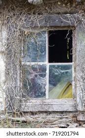 Broken window in old barn