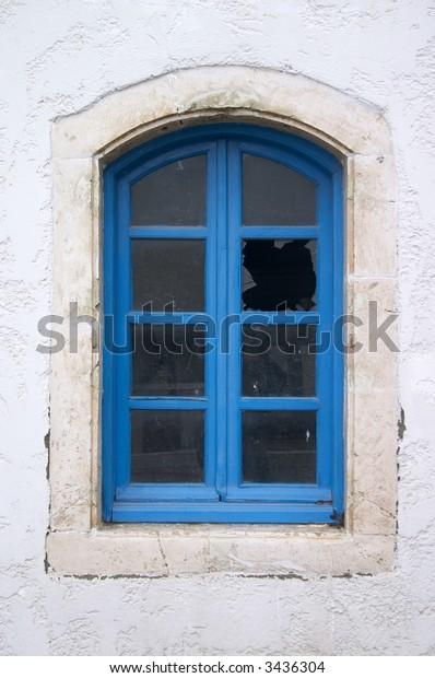 broken window in old house