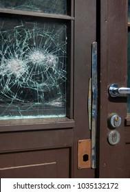 Broken window on a front door
