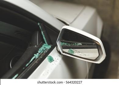 Broken window on modern sports car.