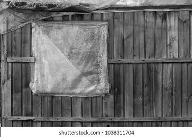 broken window in slums, closeup