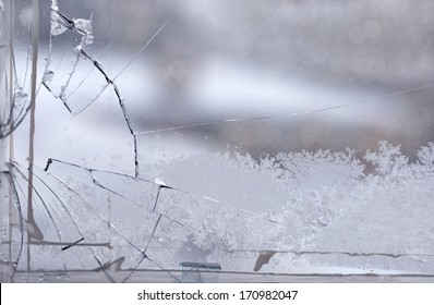 Broken window in the winter time with frost on the glass