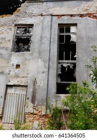 Broken windows in abandoned house