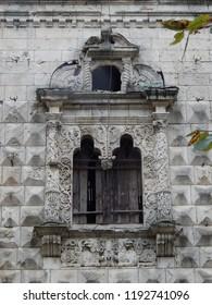 Broken windows of a beautiful ruined building