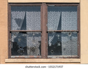 Broken windows with lace curtains.  Image taken at the old Scranton Lace Factory, built in 1890, closed in 2002, demolished in 2019.