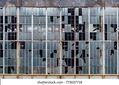 Broken windows in an old abandoned industrial building