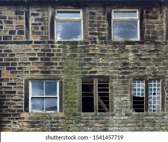 broken windows in an old derelict stone house