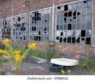 Broken windows in an old industrial building
