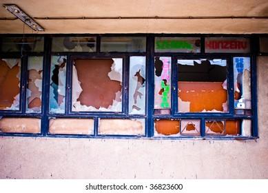 broken windows on factory wall