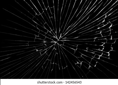 Broken windshield glass on a black background