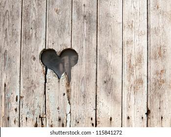 broken wooden heart medieval door representing background for lost love