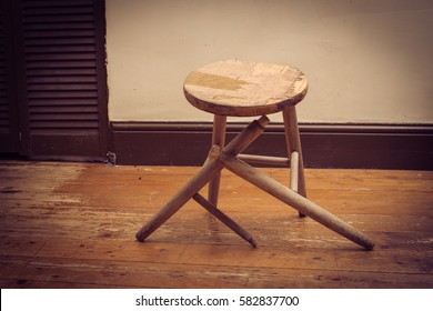 broken wooden stool in abandoned house