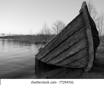 Broken wooden-boat at the beach