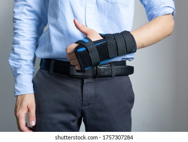 Broken wrist concept. Cast broken arm and wrist for immobilize after arm and hand injury. Man using Thumb splint. Inflammation of the tendons in the thumb. Healthcare and insurance concept.