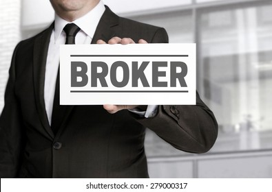 Broker sign is held by businessman