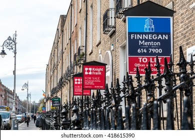 Brokerage signs for sale, apartments and offices.  Dublin city, Ireland - April 21, 2016: Several brokerage signs in a row outside apartments, offices. Brokerage signs, for sale, to let.