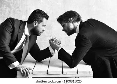 Brokers arm wrestling in office