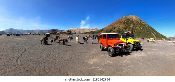 BROMO, INDONESIA -12 Sep 2018; Colourful tourist jeeps with horse at the parking areas on 12 September 2018, bromo crater in savanna of Tengger caldera at Mt. Bromo, East Java, Indonesia.