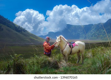 BROMO, INDONESIA - 16th APRIL 2018; A Tengger Horseman  at Magnificent Bromo Tengger Semeru National Park East Java Indonesia.