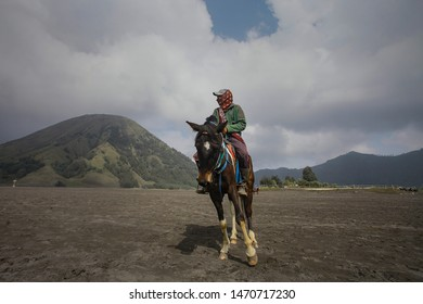 BROMO, INDONESIA - 22ND MARCH 2019; Unidentified horse riders with his horse near Mt.Bromo in early morning.
