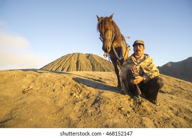 BROMO, INDONESIA - 23 July 2016; Unidentified local people or Bromo Horseman at the mountainside of Mount Bromo, Semeru, Tengger National Park, Indonesia.