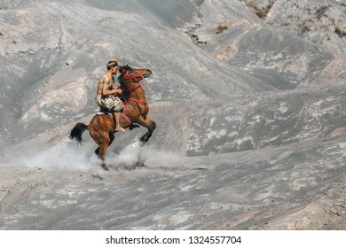 BROMO, INDONESIA. 29 JULY 2018. Local people or Bromo Horseman action for camera at the mountainside of Mount Bromo, Semeru, Tengger National Park, Indonesia.