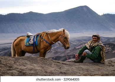 BROMO, INDONESIA - 2ND MARCH 2014; Unidentified local people or Bromo Horseman pose for camera at the mountainside of Mount Bromo, Semeru, Tengger National Park, Indonesia.