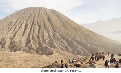 Bromo / Indonesia - April 2017: Tourists on the crater rim of active volcano mount Bromo in Bromo-Tengger-Semeru National Park in Indonesia.
