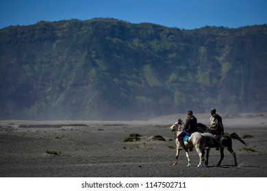BROMO, INDONESIA - JULY 23 ,.2017. Unidentified local people or Bromo Horseman at the mountainside of Mount Bromo, Semeru, Tengger National Park, Indonesia.