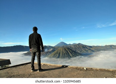 Bromo Mountain is an active volcano. Landscape view of Bromo mountain with fog around the valley from Penanjakan viewpoint at Bromo Tengger Semeru National Park , East Java, Indonesia