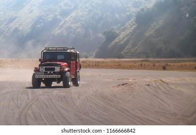 Bromo Mountain , Indonesia - JULY 17 , 2018 : The jeep car is driving at the area of Bromo Mountain Surabaya Indonesia. this car is famous for travelor.
