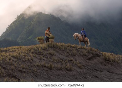 Bromo National Park, Probolinggo, East Java, Indonesia - July 14, 2017 : Meeting up between two men of the Tengger tribe in the outer caldera of Mount Bromo