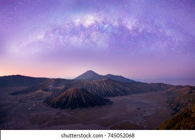 Bromo tengger semeru national park,Surabaya,Indonesia in morning. Sunrise turn into red and purple with full of milky way in the sky. There is a big great amazing nature scene. Impressive morning.