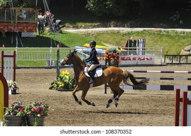 BROMONT-CANADA JULY 19: Unknown rider on a horse during 2012, INTERNATIONAL BROMONT on July 19, 2012 At the Equestrian 1976 Montreal Olympic Park.