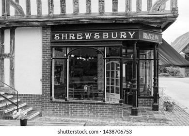 Bromsgrove, England, June 30th 2019. An old Edwardian black and white, shop front, wooden framed building