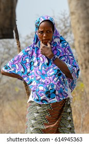 BRONG AHAFO, GHANA - JAN 15, 2017: Unidentified Fulani woman in colored beautiful national clothes stands in the local village. Fulanis are ethnic group of Ghana