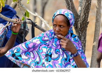BRONG AHAFO, GHANA - JAN 15, 2017: Unidentified Fulani woman in beautiful colored clothes looks away in the local village. Fulanis are ethnic group of Ghana