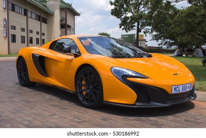 Bronkhorstspruit, South Africa - February 06, 2016: The orange sports car McLaren next to complex Nan Hua Temple in Bronkhorstspruit, South Africa.