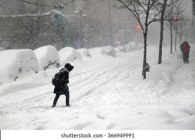 BRONX, NEW YORK - JANUARY 23: Woman crosses street during blizzard snow storm Jonas.  Taken January 23, 2016, in the Bronx,  New York.