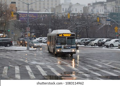 BRONX, NEW YORK - MARCH 21: Public bus travels with passengers during snow storm.  Taken March 28, 2018 in New York.