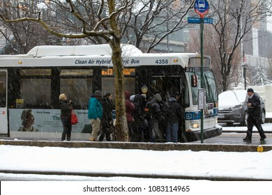 BRONX, NEW YORK - March 21: People wait to board public bus during snow storm.  Taken March 21, 2018 in New York.