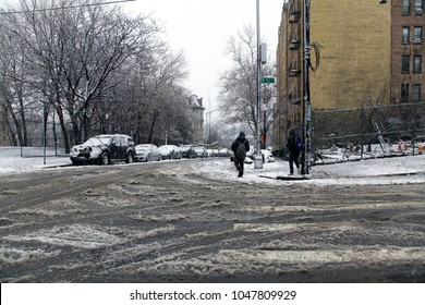 BRONX, NEW YORK - MARCH 7: Local street during snow storm at 162nd street near Yankee Stadium.  Taken March 7, 2018 in New York.