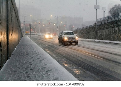 BRONX, NEW YORK - MARCH 7: Autos manage slipperfy roads during snow storm.  Taken March 7, 2018 in New York.