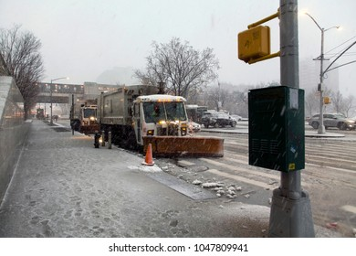 BRONX, NEW YORK - MARCH 7: Snow removal sanitation trucks parked during winter snow storm.  Taken March 7, 2018 in New York.
