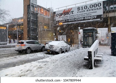 BRONX, NEW YORK - MARCH 7: Street near Yankee Stadium subway stationwith cop shot ad during snow storm.  Taken March 7, 2018 in New York.
