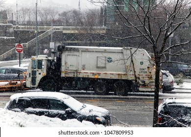 BRONX, NEW YORK - MARCH 7: Parked sanitation vehicle equipped for snow removal during winter storm. Taken March 7, 2018 in New York.
