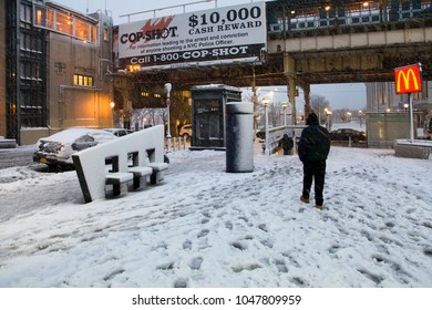 BRONX, NEW YORK - MARCH 7: Man walks to subway station during snow storm.  Taken March 7, 2018 in New York.
