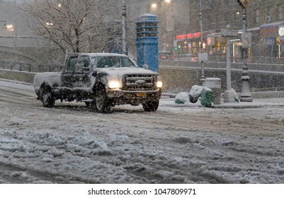 BRONX, NEW YORK - MARCH 7: Driver rides vehicle in snow storm.  Taken March 7, 2018 in New York.