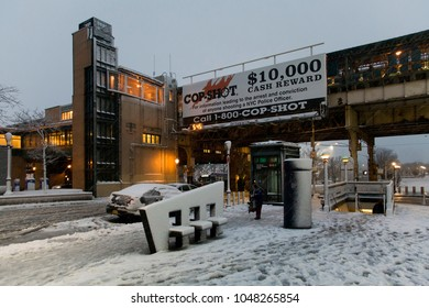 BRONX, NEW YORK - MARCH 7: Street near Yankee Stadium subway station with cop shot ad during snow storm.  Taken March 7, 2018 in New York.